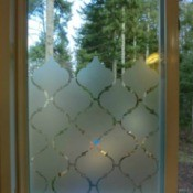 Photo of a window made more private using contact paper.