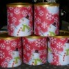 A photo of formula cans used to store gifts.