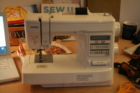 Portable sewing machine.