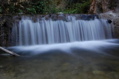 Wide low waterfall.