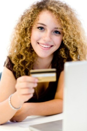 A girl college student with a credit card.