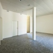 A photo of a large room with granite floors.