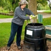 Woman using a composter