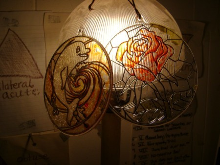 Displaying Children's Plastic Stained Glass Crafts - two plastic  stained glass circles on lamp shade