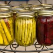 Canning jars of preserved vegetables