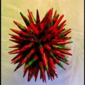 A starburst Christmas ornament made with wrapping paper.