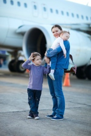 Mother Getting on Plane with Young Children