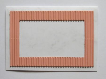 Placing corrugated frame.