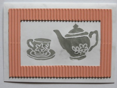 Stamped teapot and cup image.