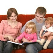 MOther and Father Reading with young CHildren