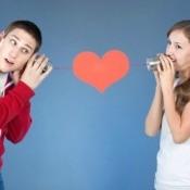 Young Man and Woman Talking Through Tin Can