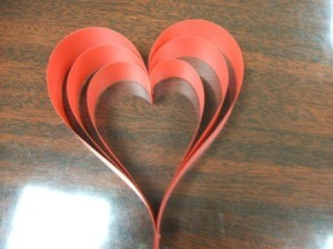 Folded red paper hearts