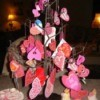Twig tree decorated with assorted Valentines.