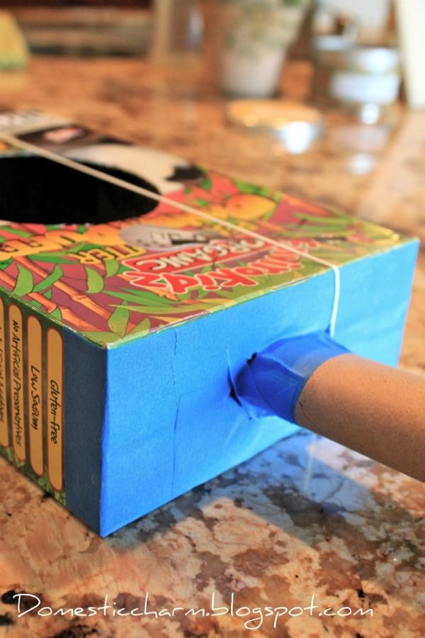 Making a Cereal Box Guitar | ThriftyFun on making house, cracker box house, waffle box house, cardboard box house,