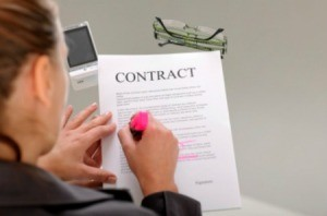 A woman signing a contract.