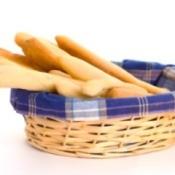 A basket of long slender breadsticks.