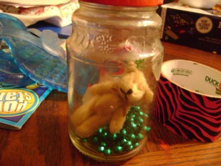 Toys in jar.