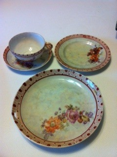 Dishes from set. Cup and saucer, plate, and serving plate.