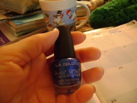 Bottle of blue nail polish.