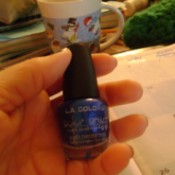Bottle of blue nail polish.