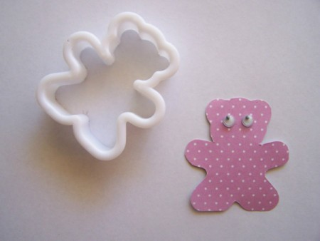 Bear cookie cutter and paper bear shape.