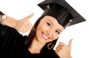 A girl who has graduated, wearing her cap and gown.