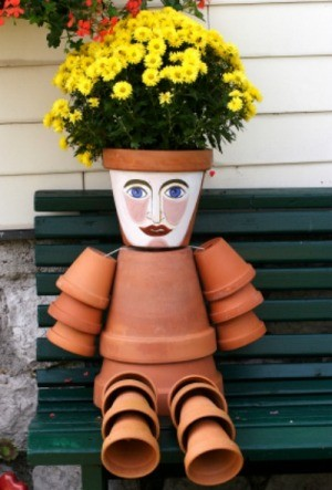 terra cotta flower pot person