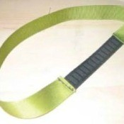 Green ribbon headband with elastic section.