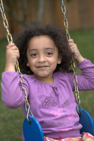 Girl On Outdoor Play Equipment