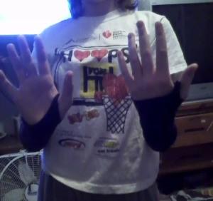 Girl wearing wrist warmers.