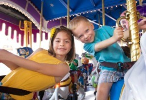 Two kids at an amusement park.