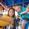 Two kids at an amusement park.