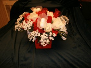 Red and white silk flowers in red box.