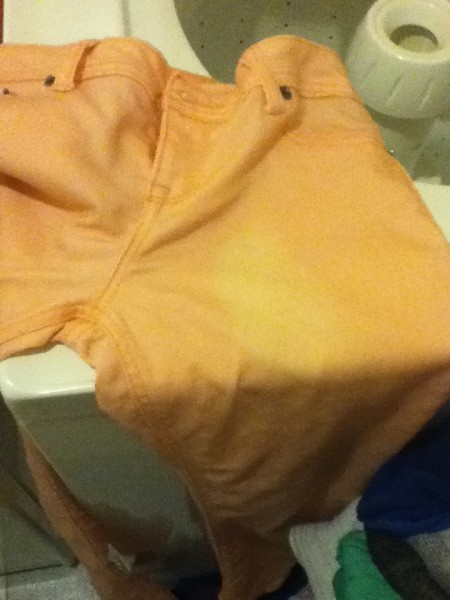 Pants with bleach marks.