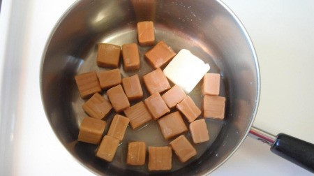 Caramels and butter in pan.