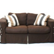 Upholstered couch with soft cushions.