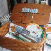 Picnic basket used to hold art supplies.