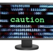 "Computer screen says ""Caution""."