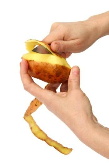 Peeling a potato.