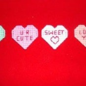 Plastic canvas heart magnets.