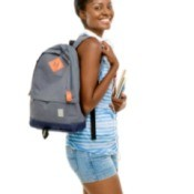A girl with a backpack on.