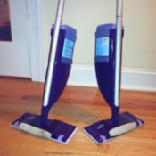 Two Wet Jet mops.