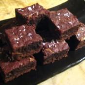 A plate of mini sea salt caramel brownies.