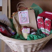 "A gift basket with a theme of ""Dinner and a Movie""."