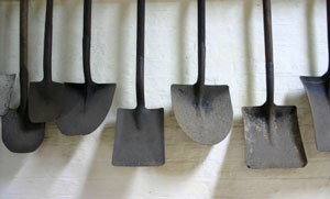Hanging shovels and spades.