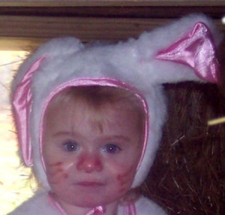 A toddler in a bunny costume.