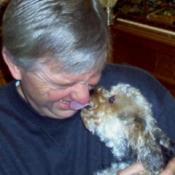 Dog giving man a kiss.