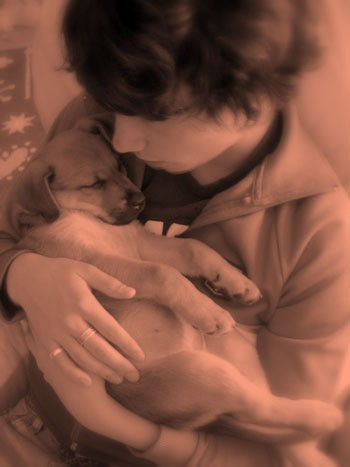 Boy holding puppy.