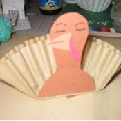 Brown coffee filter and construction paper turkey.