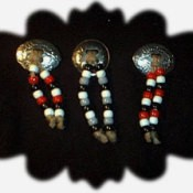 Three pins made from western conchos and beads.